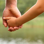 Father's hand lead his child son — Stock Photo
