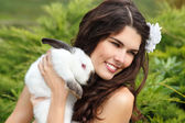 Young woman bride holding rabbit — Foto Stock