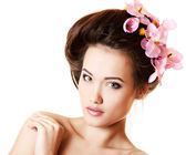 Teen girl with flower orchid — Stock Photo