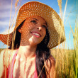 Young womwearing sun hat — Stock Photo #12079557