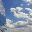 Stock Video: Office building cloud reflection