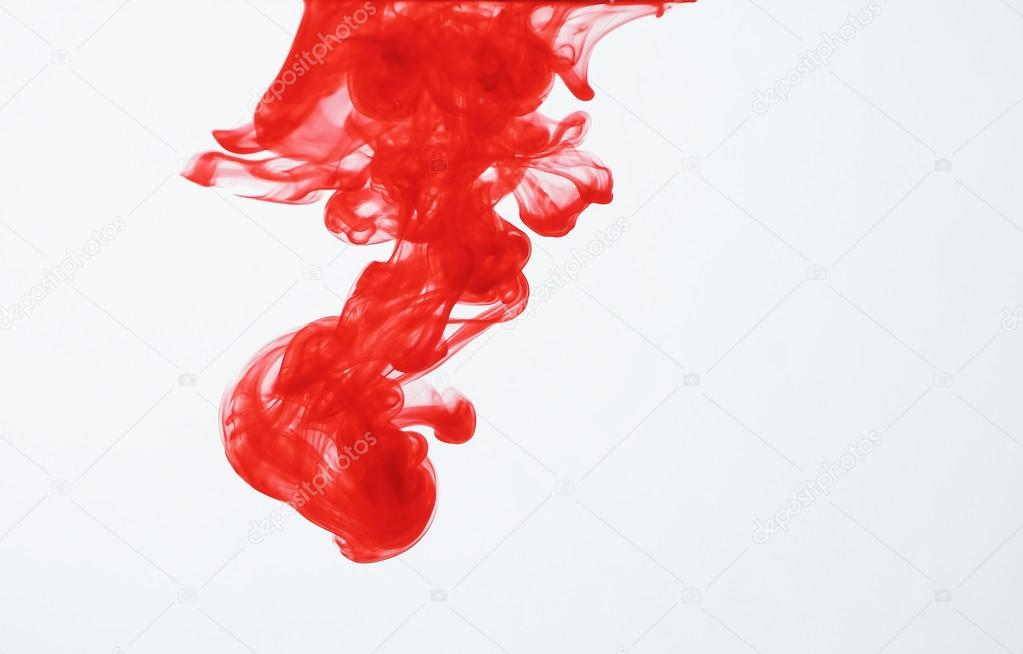 Red ink dispersing in water — Stock Photo #19737053
