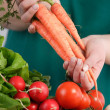 Woman holding a bunch of carrots — Stock Photo #23674155