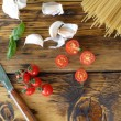 Spaghetti, cherry tomatoes and garlic. Cooking dinner — Stock Photo