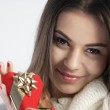 Happy girl holding a gift — Stock Photo