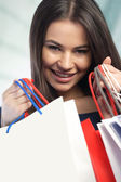 Donna felice azienda shopping bags — Foto Stock