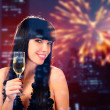 Stock Photo: Smiling woman holding a glass of champagne