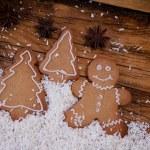 Gingerbread man, winter setting — Stock Photo