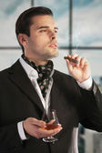 Man smoking cigar and drinking cognac — Stock Photo