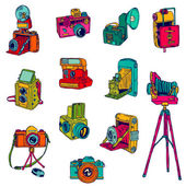 Set of Photo Cameras - hand-drawn doodles - in vector — Stock Vector