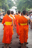 Buddhist missionary monk. Standing in a row for the cult. — Stock Photo