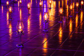 Lamps were lit and placed on the ground. — Stock Photo