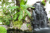Waterfall in decorated garden — Photo