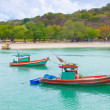 Stock Photo: Small fishing boats moored in the sea.