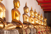 Buddha in a long line. — Stock Photo