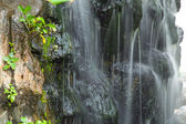 Waterfall in decorated garden — Stockfoto