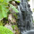 Waterfall in decorated garden — Stock Photo