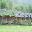 Huts near mountain — Stock Photo #37805081