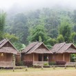 Huts near mountain — Stock Photo #37807759