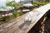 Coffee laid on wooden terrace — Stock Photo