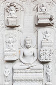 Ancient brick carving art of Buddha — Stock Photo