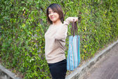 Portrait Asian woman Standing and holding bag — Stock Photo