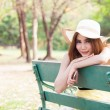Asian women sitting on a bench in the park. — Stock Photo #44105257