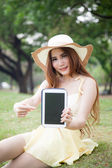 Asian women filed tablet and pointing to the tablet. — Stock Photo