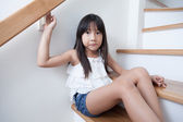 Girl sitting in on the ladder — Stock Photo