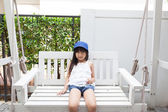 Girl sitting on a swing — Stock Photo