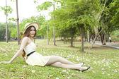 Woman sitting on lawn — Foto de Stock