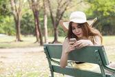 Woman playing smart phone. — Stock Photo