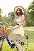Asian woman and bicycle — Stock Photo