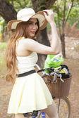 Portrait Asian woman riding a bike. — Stock Photo