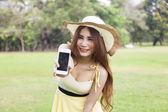 Woman handing the smart phone — Stock Photo