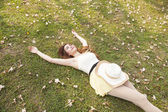 Woman lying on the grass. — Stock Photo