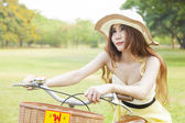 Asian woman sitting on a bicycle — Stock Photo