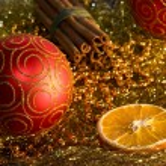 Red christmas ball, cinnamon, orange and beads — Stock Photo #16853701