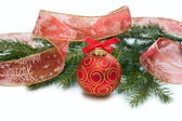 Christmas red ball, twig of fir , ribbon with drawing of tree an — Stock Photo