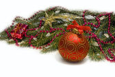 Christmas red ball, twig of fir , red beads — Stock Photo
