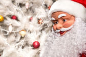 The doll in the form of Santa Claus on a white background Christ — Stock Photo