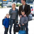 Family waiting for the bus — Stock Photo