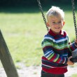 Boy with swing — Stock Photo #44705693