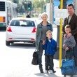 Family waiting for the bus — Stock Photo #44705825