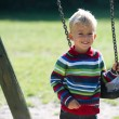 Boy with swing — Stock Photo #44705921