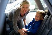Mother fastening son's seatbelt — Stock Photo
