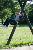 Boy swinging — Stock Photo