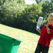 Boy recycling bottle — Stock Photo