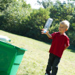 Boy recycling bottle — Stock Photo #45075753