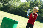 Boy recycling bottle — Foto de Stock